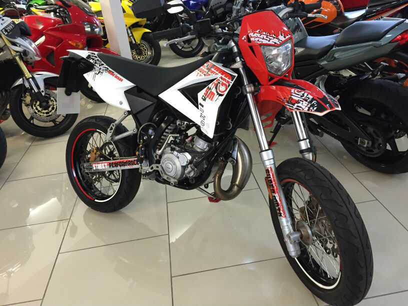 cpi supermoto sm 50cc 2013 63 reg red and white full tecnigas exhaust system. Black Bedroom Furniture Sets. Home Design Ideas